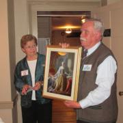Photo of Peter Fischer presenting a portrait of Queen Charlotte of Mecklenburg