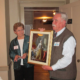 Photo of Peter Fischer presenting a portrait of Queen Charlotte of Mecklenburg
